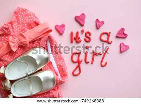 Girl lettering plasticine pink letters on stock photo download now its a girl lettering with plasticine pink letters on pink background set of baby shoes stopboris Gallery