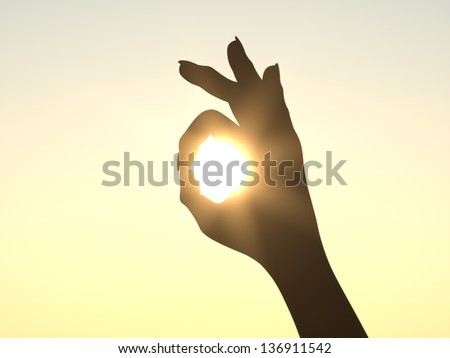 It's All Right - Hand in front of Sun - stock photo