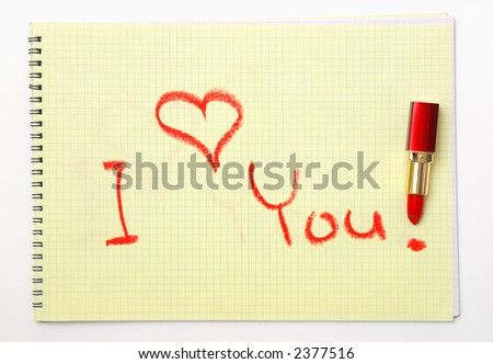 It's an 'I love you!' message written on a yellow sheet of paper with the red lipstick. - stock photo