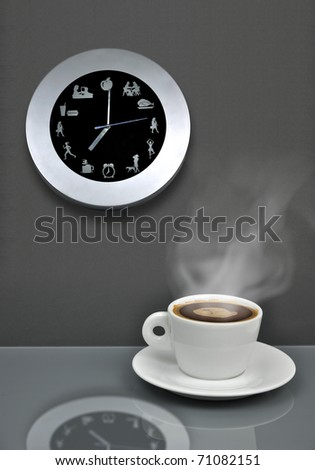 It's coffee break time - metaphor with clock and cup of coffee - stock photo