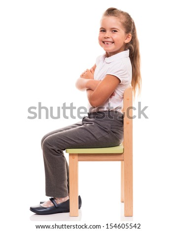 it's comfortable to posing while sitting on a chair - stock photo