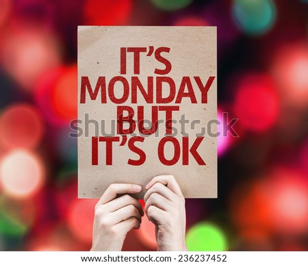It's Monday But It's Ok card with colorful background with defocused lights - stock photo