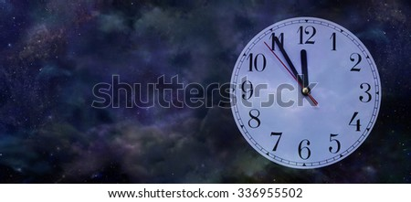 It's Nearly New Year - Wide night sky background with a clock face showing five minutes to midnight on the right side and copy space on left - stock photo