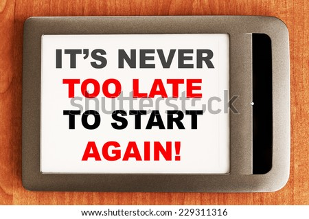 It's never too late to start again written in e-book Motivational concept - stock photo