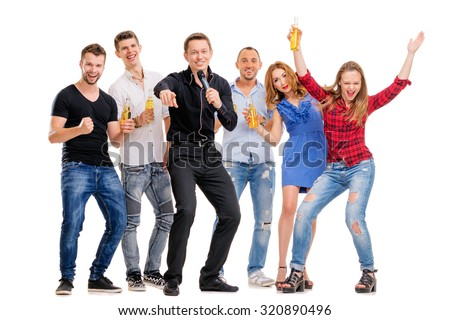 It's party time! Group of happy smiling friends with bottles of beer having fun together. Isolated on white. - stock photo