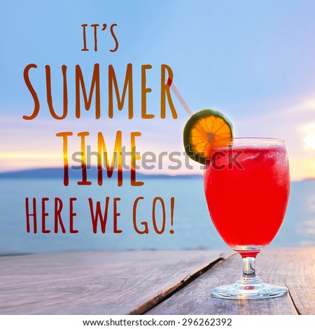 IT'S SUMMER TIME HERE WE GO text and red cocktail drink on sea background - stock photo
