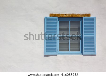 It's time for a vacation! Mediterranean style blue shutters on a white-washed wall, with space for text - stock photo