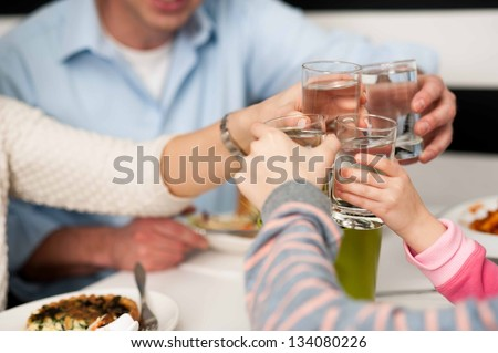 It's time to celebrate. Family toasting. - stock photo