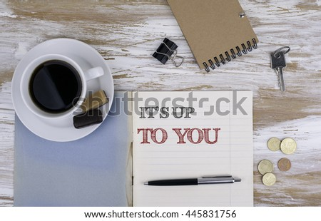 It's Up To You. Copybook on the desktop - stock photo