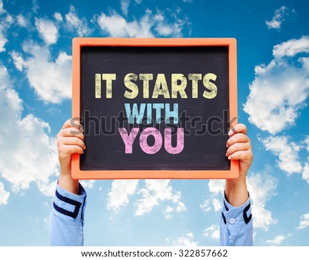 It Starts With You!, word on chalkboard. - stock photo