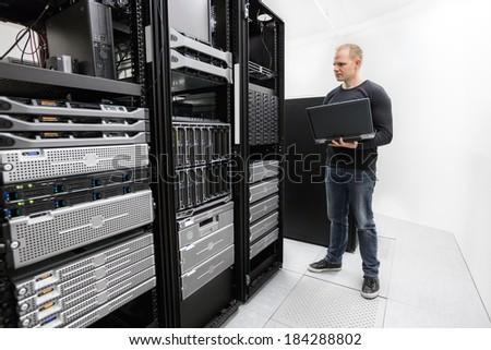 It technician monitors data center - stock photo