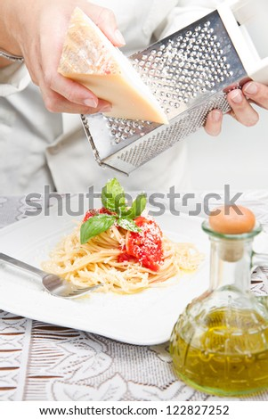itakian pasta with grated parmesan - stock photo