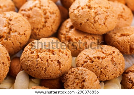 Italian almond cookie amaretti and almonds on white vintage table, food concept. Selective focus. - stock photo