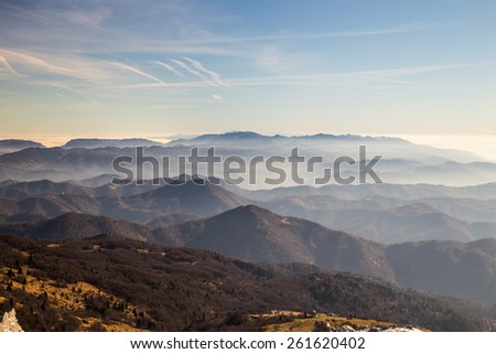Italian alps with snow in a sunny winter day - stock photo