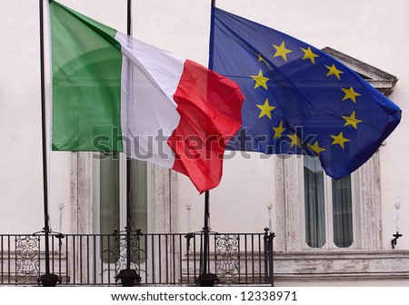 Italian and European union flags at Montecitorio palace, the seat of the Italian Chamber of Deputies, Rome - stock photo