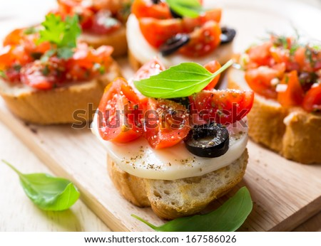 Italian Appetizer Bruschetta with Caprese Salad - stock photo