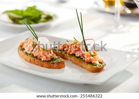 Italian Appetizer Bruschetta with Salmon - stock photo