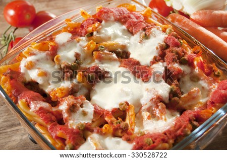 Italian baked pasta with mozzarella tomato sauce and beef ground