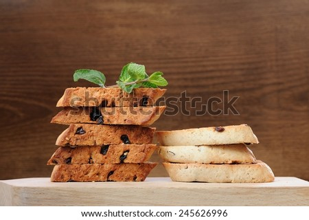 Italian biscotti in two piles with fresh mint with space - stock photo