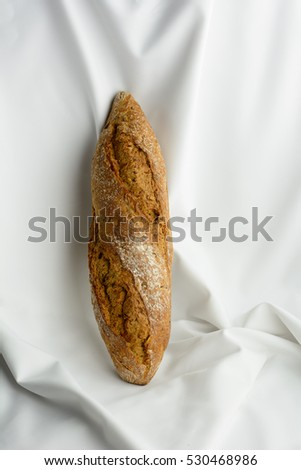 Italian bread, rustic bread isolated on white silk background, loaf of bread isolated, Delicious bread, French baguette on a white background made from flour. baking. space for text