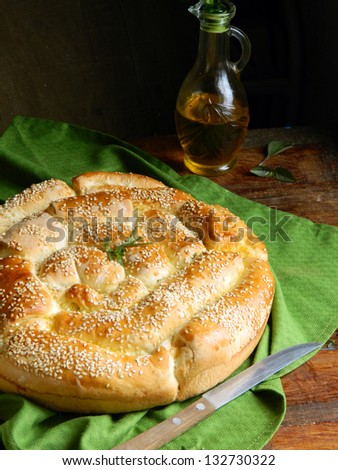 Italian bread with Parmesan cheese and herbs - stock photo