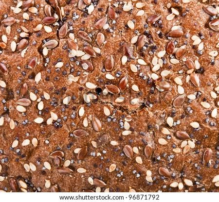 Italian bread with sesame seeds, flax, coriander - stock photo