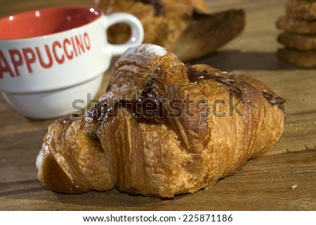 Italian breakfast: chocolate croissants and cappuccino