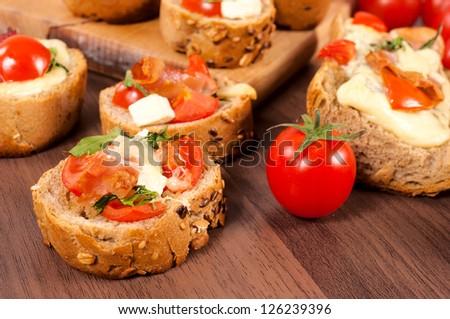 Italian bruschetta sandwich on the wooden background - stock photo