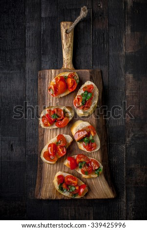 italian canapes set on vintage wooden board - stock photo