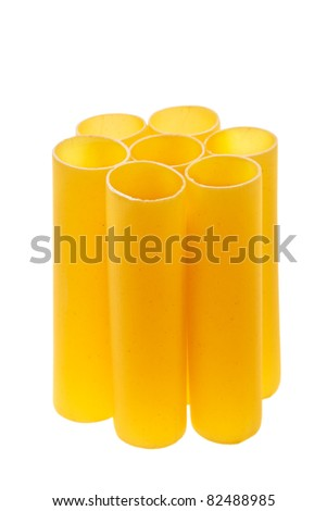 Italian cannelloni pasta tubes isolated over white background. - stock photo