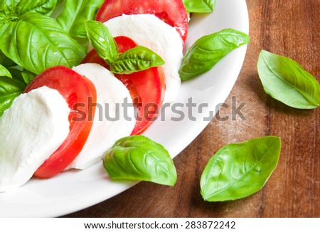 Italian Caprese Salad with Mozzarella Cheese, Tomatoes and Basil - stock photo