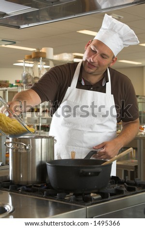 Italian chef adding the pasta to the boiling water