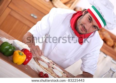 Italian chef making pizza - stock photo