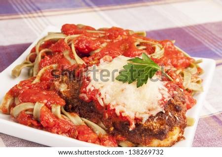 Italian chicken Parmesan or parmigiana in spaghetti souse - stock photo