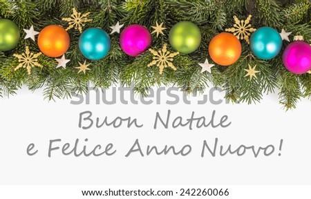 italian Christmas card Christmas baubles, fir branches, golden stars and text Merry Christmas and a happy New Year/Merry Christmas and a happy New Year/italian  - stock photo