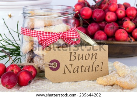 italian Christmas card with vanilla crescents and text merry christmas/merry christmas/italian - stock photo