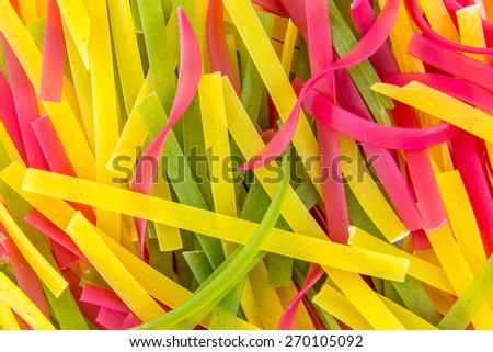 Italian colorful tagliatelle pasta texture background - stock photo