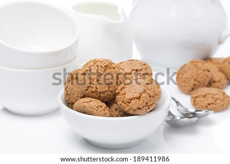 Italian cookies amaretti and crockery for teatime, close-up - stock photo