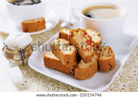 Italian cookies (biscotti) and a cup of coffee (selective focus, shallow depth of field) - stock photo