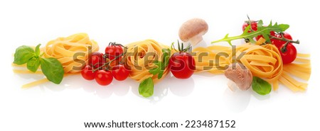 Italian cooking and ingredients horizontal banner with dried pasta or noodles, cherry tomatoes, fresh basil and garlic cloves on a white background - stock photo