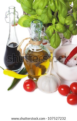 Italian cuisine - olive oil, balsamic vinegar with cherry tomatoes, pepper and basil - stock photo