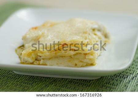 Italian dish Lasagne al pesto - stock photo