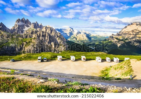 Italian Dolomites landscape and parking in front of the shelter Lavaredo ful of campers, Dolomites Mountains, Italy - stock photo