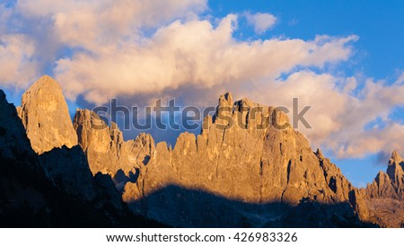 "Italian dolomites. Mountain landscape from ""San Martino di Castrozza"" during ""Enrosadira"" phenomenon. Geological formations"