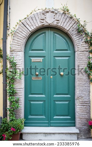 Italian elegant door of a Tuscan house - stock photo