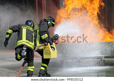 Italian firefighters in action during an exercise in the Firehouse - stock photo