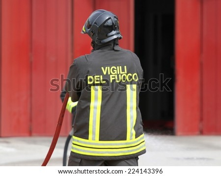 Italian fireman with uniform after switching off fire