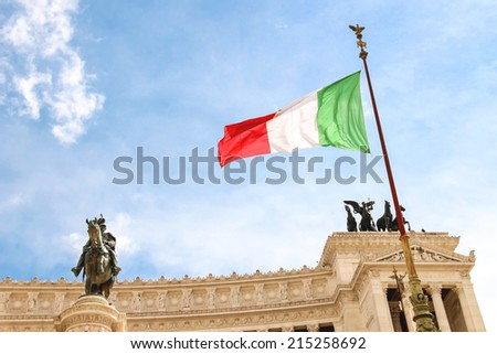 Italian flag at the monument to Victor Emmanuel II. Piazza Venezia, Rome, Italy. - stock photo