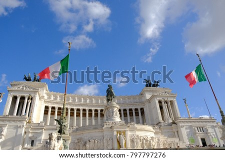 Italian flag fluttering against the Altar of the Fatherland from Piazza Venezia, Rome, Italy