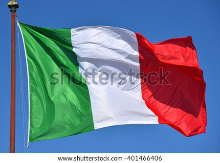 Italian flag fluttering in the wind, with blue sky. Green, White, Red and Azure are Italian national colors.